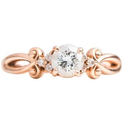 1950s Diamond and 14 Karat Rose Gold Engagement Ring