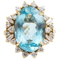 7 Carat Oval Aquamarine with Diamond Halo 18 Karat Yellow Gold Ring