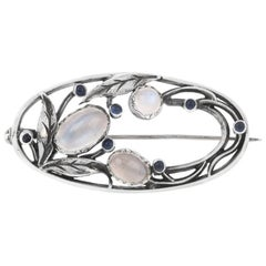 Arts and Crafts Silver Moonstone and Sapphire Brooch