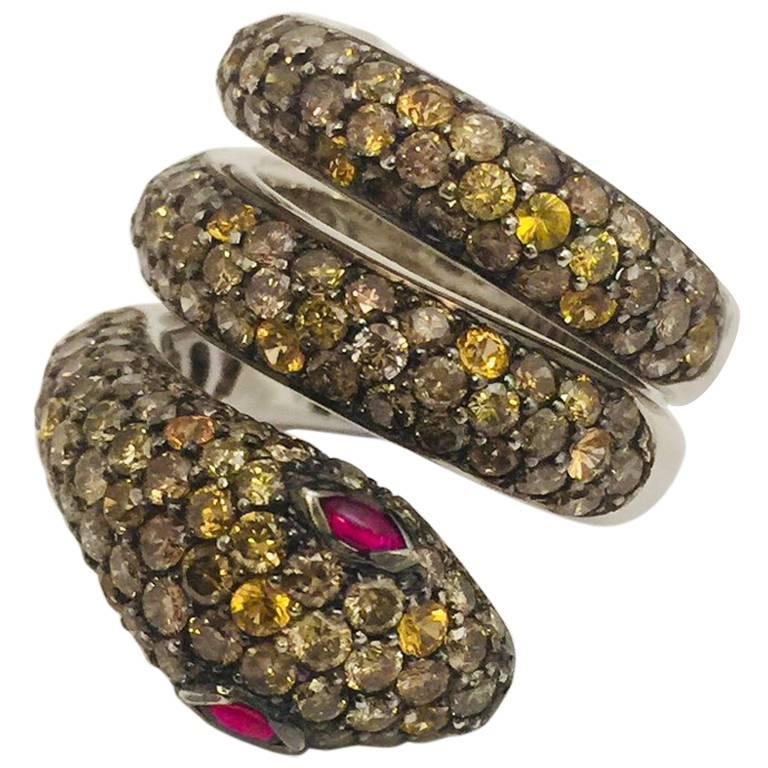 18 Karat Striking Snake Ring with Diamonds, Yellow Sapphires and Rubies
