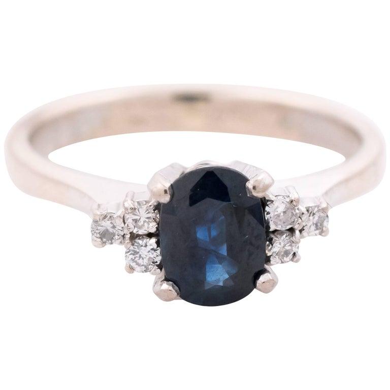 1950s 1 Carat Oval Blue Sapphire and Diamond 18 Karat White Gold Ring
