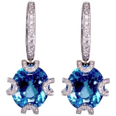 Highly Crafted 18K Gold Diamond Earrings with Electric Blue Zircon Color Stones