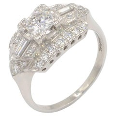 Vintage 1950s 0.46 Carat Diamond Center and Platinum Engagement Ring