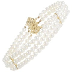 Triple Strand Freshwater Pearl Bracelet with 14 Carat Yellow Gold