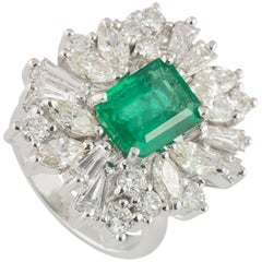 Asymmetrical Diamond and Emerald Ring
