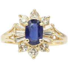 14 Karat Yellow Gold .80 Carat Natural Sapphire and Diamond Halo Ring