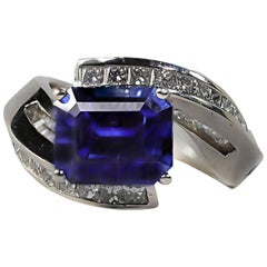 Nova Sapphire and Baguette and Princess Cut Diamond By-Pass Ring