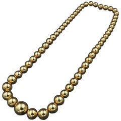 Important Long Gold Ball Necklace, circa 1960