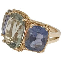 Elegant Three-Stone Ring with Gold Rope Twist Border