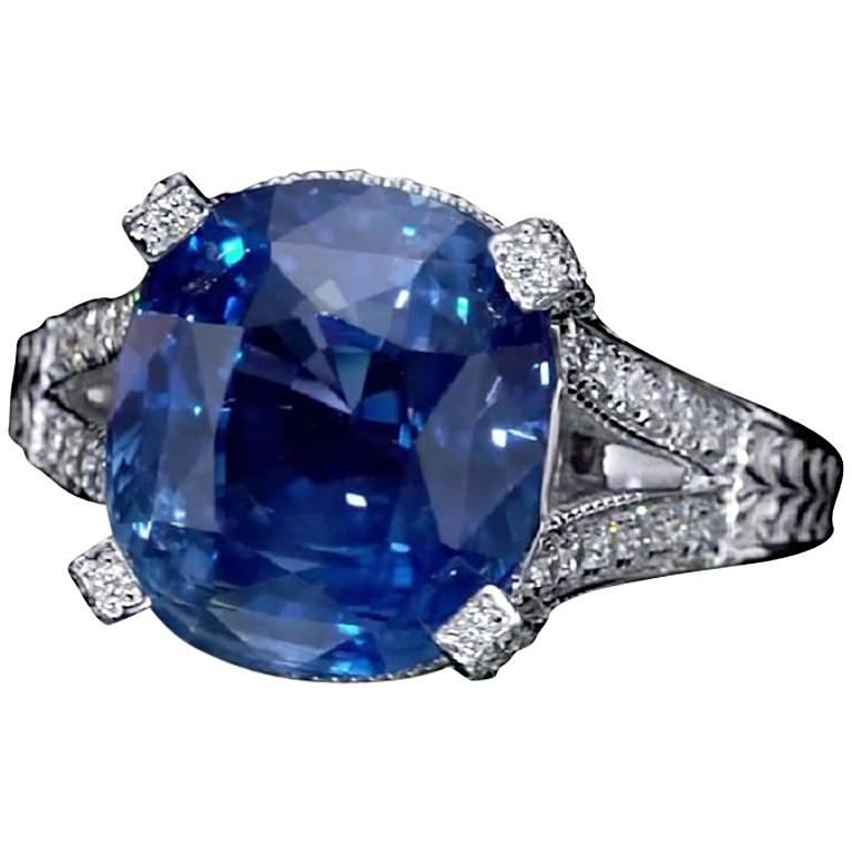 Handcrafted elegant 11.01 Carat cushion cut blue sapphire ring, GRS Certified, surrounded by 76 diamonds and mounted on 18K white gold.   Jewel Details:  Center- 11.01 Carat Cushion Cut Blue Sapphire, GRS certified. Side-  75 Round Diamonds, 0.70