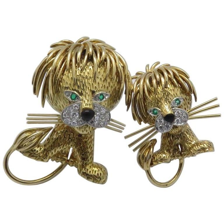 "1970s Van Cleef & Arpels ""Lion"" Diamond Emerald Black Enamel Gold Brooches"