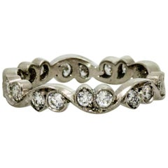 0.65 Carat Diamond Platinum Swirling Eternity Band