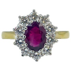 1.04 Carat Ruby and 0.80 Carat Diamond Cluster Ring, 18 Carat Gold, London, 2009