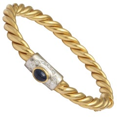 Center Cabochon Sapphire and Diamond Yellow Gold Bangle