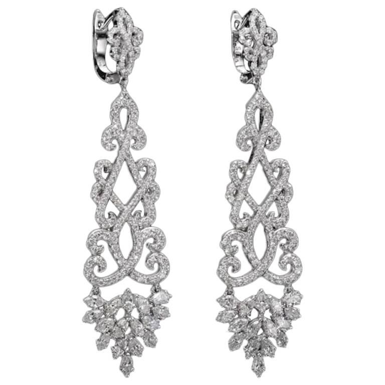 Classic Diamond Chandelier Earrings 4.22 Carat Total Diamond Weight.  Our handcrafted earrings will compliment everybody's wardrobe, they can complete a red carpet look and upgrade a casual look.  The earrings are set with high quality round