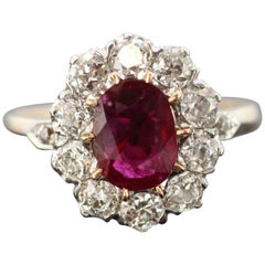 18 Karat Yellow Gold Oval Ruby Diamond Cluster Ring, circa 1970s