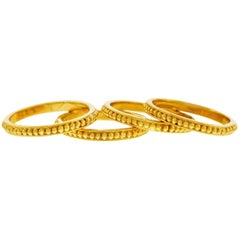 Set of 4 Archaic Motif 22k Gold Rings