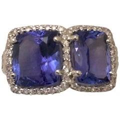 18 Karat Tantalizing Tanzanite and Diamond Ring
