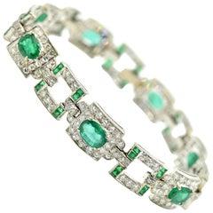 18 Karat White Gold, Art Deco 6.60 Carat Emerald and 5.65 Carat Diamond Bracelet