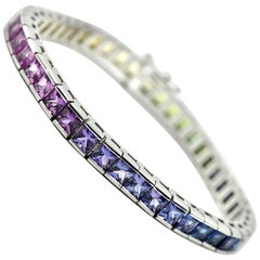 14 Karat White Gold and 10.1 Carat Blue Sapphire In-Line Tennis Bracelet