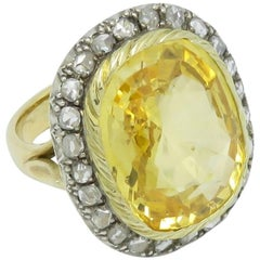 Certified 24.43 Carat Natural Yellow Sapphire and Diamond Halo Engagement Ring