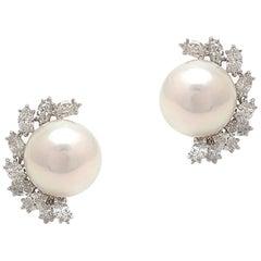 Elegant Pearl and Diamond Earrings in Platinum
