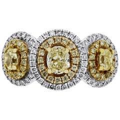 Fancy Yellow and White Diamond Three-Stone Halo Ring