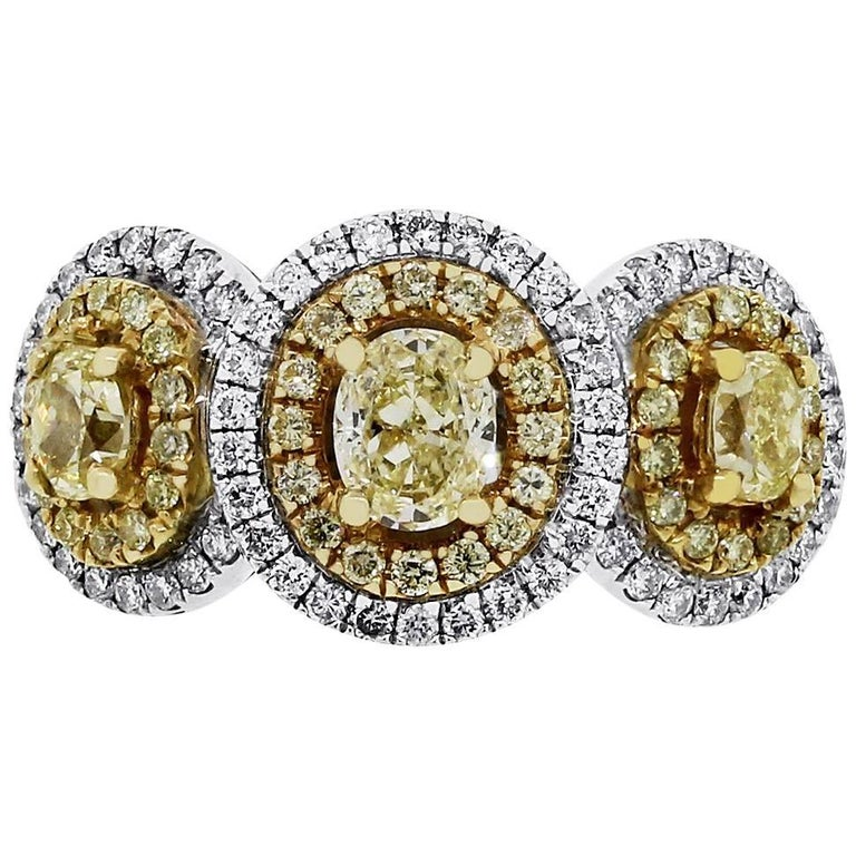 Fancy Yellow and White Diamond Three-Stone Halo Ring For Sale