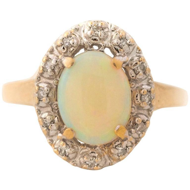 1960s Opal and Diamond Halo 14 Karat Yellow Gold Ring