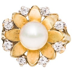 1960s Pearl and Diamond Halo 14 Karat Yellow Gold Ring