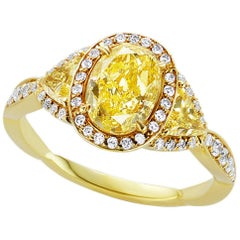 GIA Certified 1.51 Carat Oval and Trillion Natural Fancy Yellow Diamond Ring