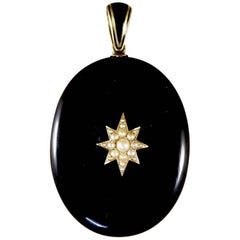 Victorian Pearl and Black Onyx Mourning Pendant in 15 Carat Gold