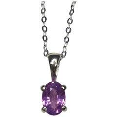 Vivid 0.69 Carat Ceylon Purple Pink Sapphire 18 Karat Gold Solitaire Pendant