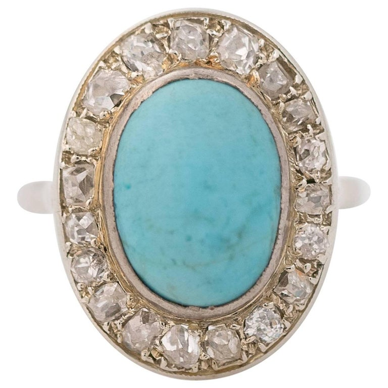 1930s Diamond and Turquoise 14 Karat White Gold Halo Ring