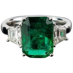 3.17 carat Emerald and Diamond Three Stone Ring