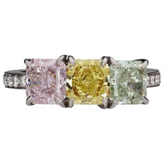 Fancy Color Radiant Cut Three Stone Platinum Diamond Ring GIA Certified