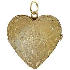 Engraved Gold Locket for Four Pictures