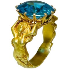 Highly Sculpted Art Nouveau Mermaid Ring centering a Very Fne Zircon
