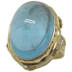 26.12 Carat Aquamarine Cabochon Ring 18 Karat Yellow Gold with Diamonds