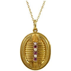 Antique Victorian Pearl Garnet Pendant Locket on a 15 Carat Gold Chain