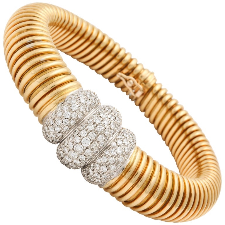 1980s Flexible Tubogas Snake Diamond and High Polish Ridged Gold Bracelet