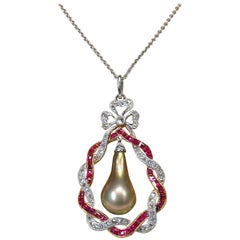 Edwardian Bronze Natural Pearl Drop Rubies Diamonds Pendant