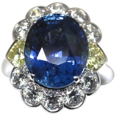 GRS Certified Natural Oval 9.99 Carat Sapphire with Yellow Heart Shape Diamonds
