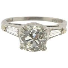 Art Deco Platinum Old Cushion Cut Diamond and Baguette Cut Diamond Ring