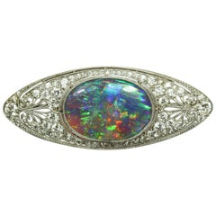 Marcus and Co. Black Opal, Diamond and Platinum Brooch, 1917