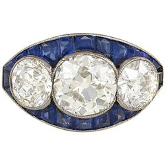 Art Deco Three-Stone Diamond and Calibré Sapphire Ring