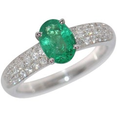 Oval Emerald and White Diamonds on White Gold 18 Carat Engagement Ring