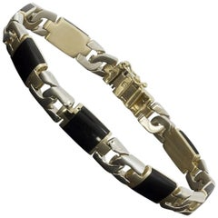 Black Onyx and 14 Karat Two-Tone Gold Curb Link Bracelet