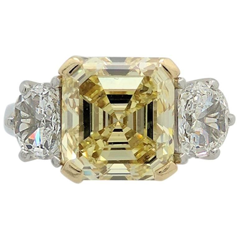 GIA 5.01ct Natural Fancy Yellow Emerald Cut Diamond Engagement Ring VS1