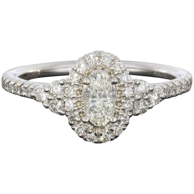 0.34 Carat Oval Halo 14 Karat White Gold Diamond Engagement Ring